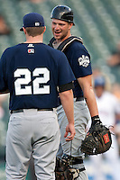 New Orleans Zephyrs catcher Cole Armstrong #9 meets with pitcher Tom Koehler #22 on the mound during the Pacific Coast League baseball game against the Round Rock Express on April 30, 2012 at The Dell Diamond in Round Rock, Texas. The Zephyrs defeated the Express 5-3. (Andrew Woolley / Four Seam Images)