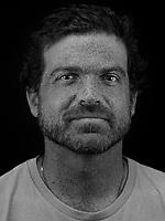 Portrait made using ultraviolet light of VII photographer Zackary Canepari.
