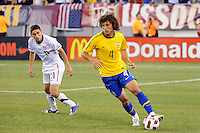 David Luiz (4) of Brazil is marked by Alejandro Bedoya (11) of the United States. The men's national team of Brazil (BRA) defeated the United States (USA) 2-0 during an international friendly at the New Meadowlands Stadium in East Rutherford, NJ, on August 10, 2010.