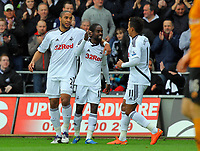 FAO SPORTS PICTURE DESK<br /> Pictured:Nathan Dyer of Swansea (C) celebrating his goal with team mates Ashley Williams (L) and Scott Sinclair (R). Saturday, 28 April 2012<br /> Re: Premier League football, Swansea City FC v Wolverhampton Wanderers at the Liberty Stadium, south Wales.