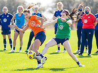 ORLANDO, FL - JANUARY 20: Emily Fox #27 is defended by Rose Lavelle #16 of the USWNT during a training session at the practice fields on January 20, 2021 in Orlando, Florida.