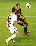 Rayo Vallecano's Adrian Embarba (l) and FC Barcelona's Neymar Santos Jr during La Liga match.September 21,2013. (ALTERPHOTOS/Acero)