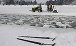 Jerry Elsen drives the tractor pulling a saw cutting blocks of ice. DOUG WOJCIK/STEVENS POINT JOURNAL