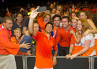 September 14, 2014, Netherlands, Amsterdam, Ziggo Dome, Davis Cup Netherlands-Croatia, Robin Haase (NED) makes a selfie with fans<br /> Photo: Tennisimages/Henk Koster