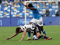 11th September 2021; Maradona Stadium, Naples, Italy; Serie A football, SSC Napoli versus Juventus  FC: Manuel Locatelli of Juventus tackled by Andre Anguissa of Napoli