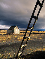 Outbuilding and ladder with storm clouds. Summer Lake State Wildlife Refuge, Oregon.
