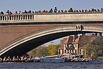 Boston, women rowers racing, 2006 Head of the Charles Regatta, Cambridge, Massachusetts, USA. Saturday October 21, 2006, Club Eights Women rowing beneath the Weeks Foot Bridge, Harvard University's Weld Boathouse in the distance,