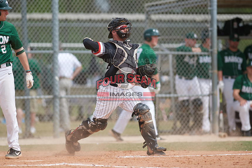 Edgewood Eagles catcher Jacob Popp (20) throws down to second base during a game against the Babson Beavers on March 18, 2019 at Lee County Player Development Complex in Fort Myers, Florida.  Babson defeated Edgewood 23-7.  (Mike Janes/Four Seam Images)