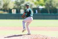 Oakland Athletics relief pitcher Leudeny Pineda (59) delivers a pitch during an Instructional League game against the Los Angeles Dodgers at Camelback Ranch on September 27, 2018 in Glendale, Arizona. (Zachary Lucy/Four Seam Images)