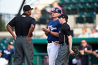 Lakeland Flying Tigers manager Andrew Graham (17) talks with the umpires during a game against the Jupiter Hammerheads on April 17, 2017 at Joker Marchant Stadium in Lakeland, Florida.  Lakeland defeated Jupiter 5-1.  (Mike Janes/Four Seam Images)
