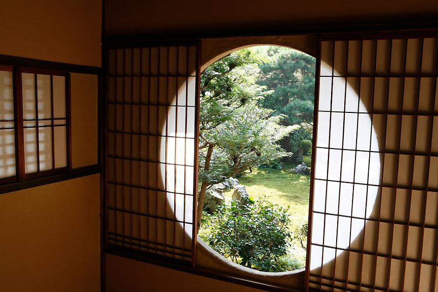 Unusual round window at Satori in Genko-an in Kyoto.