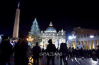 St. Peter's Square Christmas tree;Pope Francis prays in front of a Nativity scene in St Peter's square at the Vatican on December 31, 2014