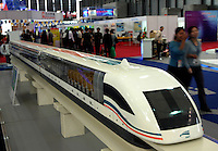Visitors look at a model of the SMT made by SAG Maglev Transportation Development Co. Ltd., in the 2004 Shanghai International Industrial Fair. Shanghai, China. The 550 km railway is one of the China Significant Achievements in Engineering..09-NOV-04