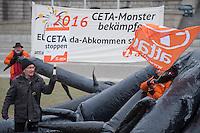 """Aktion """"Attac erlegt CETA-Monster"""" der Kampagnenorganisation attac am Montag den 4. Januar 2016 vor dem Berliner Reichstag gegen das Freihandelsabkommen CETA.<br /> 4.1.2016, Berlin<br /> Copyright: Christian-Ditsch.de<br /> [Inhaltsveraendernde Manipulation des Fotos nur nach ausdruecklicher Genehmigung des Fotografen. Vereinbarungen ueber Abtretung von Persoenlichkeitsrechten/Model Release der abgebildeten Person/Personen liegen nicht vor. NO MODEL RELEASE! Nur fuer Redaktionelle Zwecke. Don't publish without copyright Christian-Ditsch.de, Veroeffentlichung nur mit Fotografennennung, sowie gegen Honorar, MwSt. und Beleg. Konto: I N G - D i B a, IBAN DE58500105175400192269, BIC INGDDEFFXXX, Kontakt: post@christian-ditsch.de<br /> Bei der Bearbeitung der Dateiinformationen darf die Urheberkennzeichnung in den EXIF- und  IPTC-Daten nicht entfernt werden, diese sind in digitalen Medien nach §95c UrhG rechtlich geschuetzt. Der Urhebervermerk wird gemaess §13 UrhG verlangt.]"""