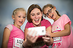 © Joel Goodman - 07973 332324 . 09/07/2017 . Manchester , UK . Mother WENDY ENGLAND (39) (c) with daughters WENDY ENGLAND (seven) (l) and ELLIE ENGLAND (nine) (r) , all from Northenden . Participants at the park ahead of the run . Race for Life charity run in aid of Cancer Research UK , in Heaton Park . Photo credit : Joel Goodman