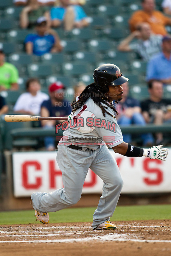 Sacramento River Cats designated hitter Manny Ramirez #11 swings during the Pacific Coast League baseball game against the Round Rock Express on May 22, 2012 at The Dell Diamond in Round Rock, Texas. The Express defeated the River Cats 11-5. (Andrew Woolley/Four Seam Images)