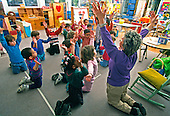 MR/ Schenectady, New York.Yates Arts-in-Education Magnet School / Pre-Kindergarten.Pre-Kindergarten teacher teaches dance movements for upcoming school performance to students (ages 4-5)..MR:YS-9-PK      FC#:23048-00510.scan from slide.© Ellen B. Senisi