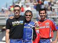Mar. 16, 2013; Gainesville, FL, USA; NHRA pro stock motorcycle riders Adam Arana (left) Hector Arana Sr (center) and Hector Arana Jr during qualifying for the Gatornationals at Auto-Plus Raceway at Gainesville. Mandatory Credit: Mark J. Rebilas-