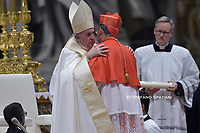 Pope Francis (R) appoints Portuguese prelate Jose Tolentino Mendonca (L) new Cardinal, during an Ordinary Public Consistory  for the creation of new cardinals, for the imposition of the biretta, the consignment of the ring and the assignment of the Title or Diaconate, on October 5, 2019 at St. Peter's Basilica in the Vatican. Pope Francis appoints 13 new cardinals at the 2019 Ordinary Public Consistory, choosing prelates whose lifelong careers reflect their commitment to serve the marginalized and local church communities, hailing from 11 different nations and representing multiple religious orders.