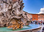 The Fountain of Four Rivers at the center of the colorful Piazza Navona (Rome, Italy) was sculpted by Gian Lorenzo Bernini in 1651.  (HDR image)