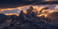 The sun sets behind Cerro Fitz Roy on a stormy evening.
