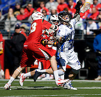 Sam Payton (32) of Duke is tangled up with Owen Blye (13) of Maryland during the Face-Off Classic in at M&T Stadium in Baltimore, MD