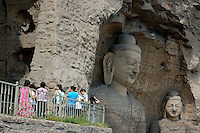 Female tourists at the Yungang Grottoes, Shanxi, China.