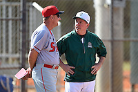 Dartmouth Big Green head coach Bob Whalen (right) talks with Rich Maloney (2) before a game against the Ball State Cardinals on March 7, 2015 at North Charlotte Regional Park in Port Charlotte, Florida.  Ball State defeated Dartmouth 7-4.  (Mike Janes/Four Seam Images)
