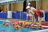 10 May 2008:  Stanford Cardinal head coach John Tanner (white shirt) and assistant coach Susan Ortwein (white cap) talk with the team before their semi-final match of the 2008 NCAA women's water polo championships at the Avery Aquatic Center in Stanford, CA.  USC defeated Stanford 10-6, to move on to the championship match against UCLA.