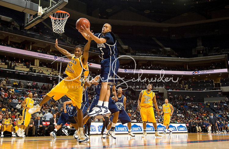 A basketball player grabs a rebound during the CIAA Tournament  in Charlotte, NC.