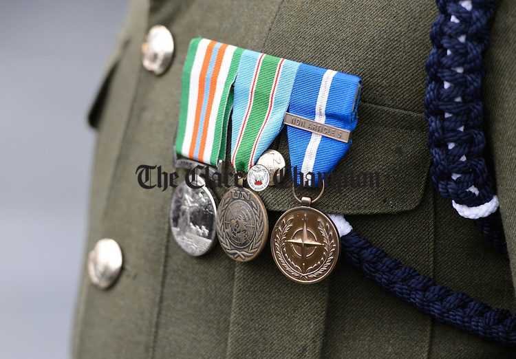 Medals pinned to a member of the 1st Batt. Galway present the tricolour at the unveiling of a commemorative stone in memory of the Kinvara Company Irish Volunteers. Photograph by John Kelly.