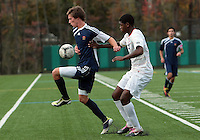 HYATTSVILLE, MD - OCTOBER 26, 2012:  Wesley Snuggs (4) of DeMatha Catholic High School defends against Nick Notaro (12) of St. Albans during a match at Heurich Field in Hyattsville, MD. on October 26. DeMatha won 2-0.