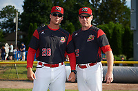 Batavia Muckdogs manager Mike Jacobs (28) and coach T.J. Gamba (12) before a game against the Auburn Doubledays on June 19, 2017 at Dwyer Stadium in Batavia, New York.  Batavia defeated Auburn 8-2 in both teams opening game of the season.  (Mike Janes/Four Seam Images)