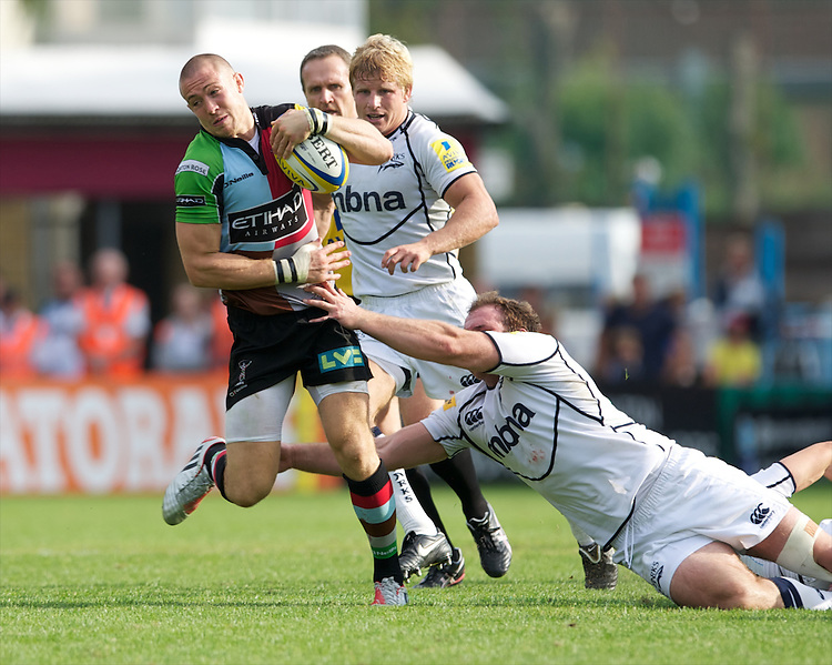 Mike Brown of Harlequins is tackled during the Aviva Premiership match between Harlequins and Sale Sharks at The Twickenham Stoop on Saturday 15th September 2012 (Photo by Rob Munro)