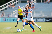 CARY, NC - SEPTEMBER 12: Sophia Smith #9 of the Portland Thorns dribbles the ball past Merritt Mathias #11 of the NC Courage during a game between Portland Thorns FC and North Carolina Courage at Sahlen's Stadium at WakeMed Soccer Park on September 12, 2021 in Cary, North Carolina.