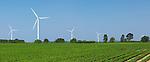 Wind turbine generators in a green field. Southern Ontario, Canada.