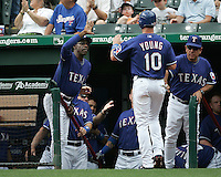 Texas Rangers Manager Ron Washington greets Michael Young after he scores in the 1st inning against the Seattle Mariners on May 14th, 2008 at Texas Rangers Ball Park in Arlington, Texas. Photo by Andrew Woolley .