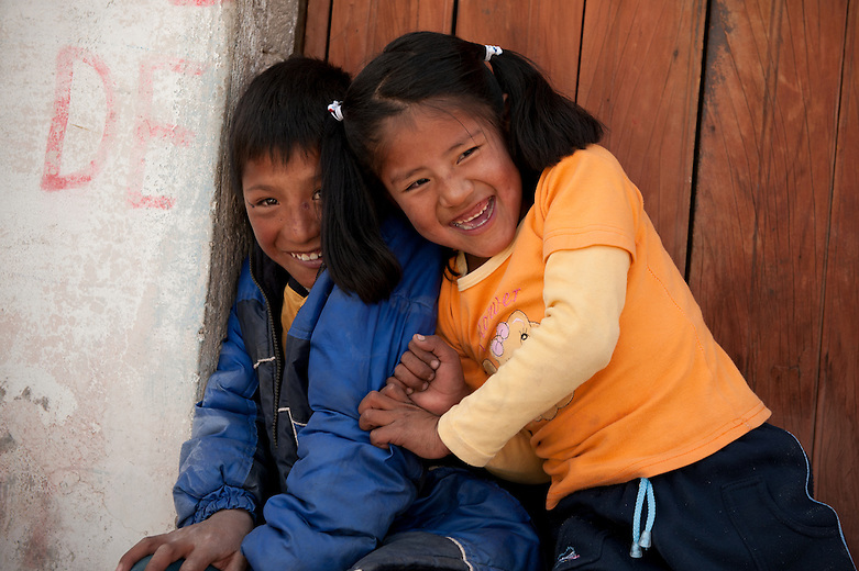 The children of the Colca Valley demonstrate pride and respect for their culture and illustrate a strong sense of tradition through their clothing, activities and work ethics. These warm and loving children enjoy interacting with one another and are very welcoming to visitors. Here in Lari, children play together enthusiastically.