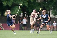 NEWTON, MA - MAY 22: Sydney Scales #45 of Boston College brings the ball forward as Madison Ahern #10 of Notre Dame and Andie Aldave #13 of Notre Dame converge during NCAA Division I Women's Lacrosse Tournament quarterfinal round game between Notre Dame and Boston College at Newton Campus Lacrosse Field on May 22, 2021 in Newton, Massachusetts.