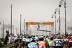 The peloton cross underneath the finish gantry during Stage 6 of the 10th Tour of Oman 2019, running 135.5km from Al Mouj Muscat to Matrah Corniche, Oman. 21st February 2019.<br /> Picture: ASO/P. Ballet | Cyclefile<br /> All photos usage must carry mandatory copyright credit (© Cyclefile | ASO/P. Ballet)
