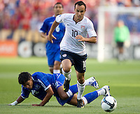 Landon Donovan of the USA carries the ball in front of Manuel Salazar #12, of El Salvador during a World Cup Qualifying match at Rio Tinto Stadium, in Sandy, Utah, Friday, September 5, 2009.  .The USA won 2-1.