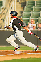 Nick Williams (1) of the Hickory Crawdads follows through on his swing against the Kannapolis Intimidators at CMC-Northeast Stadium on July 26, 2013 in Kannapolis, North Carolina.  The Intimidators defeated the Crawdads 2-1.  (Brian Westerholt/Four Seam Images)