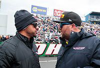 Feb 9, 2020; Pomona, CA, USA; NHRA funny car driver J.R. Todd (left) talks to top fuel teammate Shawn Langdon during the Winternationals at Auto Club Raceway at Pomona. Mandatory Credit: Mark J. Rebilas-USA TODAY Sports