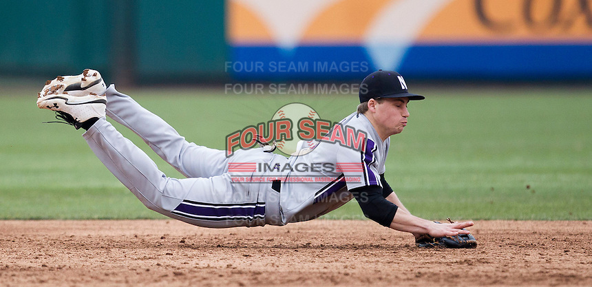 Trevor Stevens (3) of the Northwestern Wildcats makes a diving stop during a game against the Missouri State Bears at Hammons Field on March 8, 2013 in Springfield, Missouri. (David Welker/Four Seam Images)