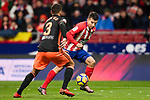 Angel Correa of Atletico de Madrid (R) fights for the ball with Ruben Miguel Nunes Vezo of Valencia CF (L) during the La Liga 2017-18 match between Atletico de Madrid and Valencia CF at Wanda Metropolitano on February 04 2018 in Madrid, Spain. Photo by Diego Souto / Power Sport Images
