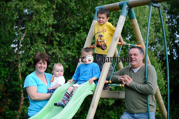 Franci and Seamus Corbett with baby Ronan, Sean and Cillian who have the condition known as Galactasemia. Photograph by John Kelly.