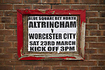 Altrincham 2 Worcester City 0, 23/03/2013. Moss Lane, Blue Square Bet North. A poster advertising  the day's Blue Square Bet North fixture between Altrincham and Worcester City at Moss Lane, Altrincham. The home team won the match 2-0 watched by 777 spectators on a day when most non-League football in England was cancelled due to adverse weather. Altrincham were historically one of the major English non-League teams but have never been promoted to the Football League. Photo by Colin McPherson.