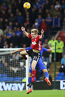 Flynn Downes of Ipswich contends with Lee Peltier of Cardiff City during the Sky Bet Championship match between Cardiff City and Ipswich Town at The Cardiff City Stadium, Cardiff, Wales, UK. Tuesday 31 October 2017