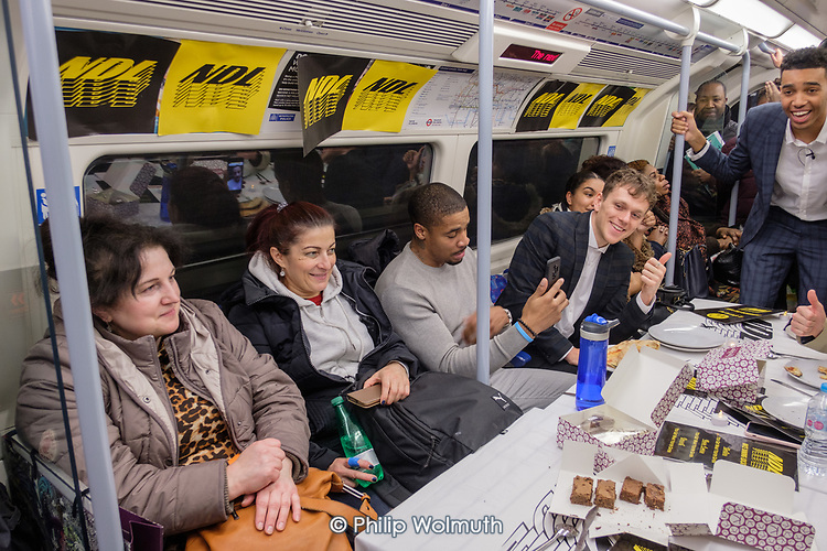 NDL impromptu restaurant on the Jubilee Line.  Tables set at Kilburn, pizzas arrive at Finchley Road, dessert at Waterloo. Impromptu restaurant on the Jubilee Line.  Tables set at Kilburn, pizzas arrive at Finchley Road, dessert at Waterloo.  Marketing stunt by YouTube influencer Niko Omilana, to promote his NDL brand clothing site.