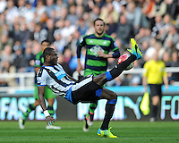 Chancel Mbemba of Newcastle United tries to clear tehe ball with an overhead kick during the Barclays Premier League match between Newcastle United and Swansea City played at St. James' Park, Newcastle upon Tyne, on the 16th April 2016